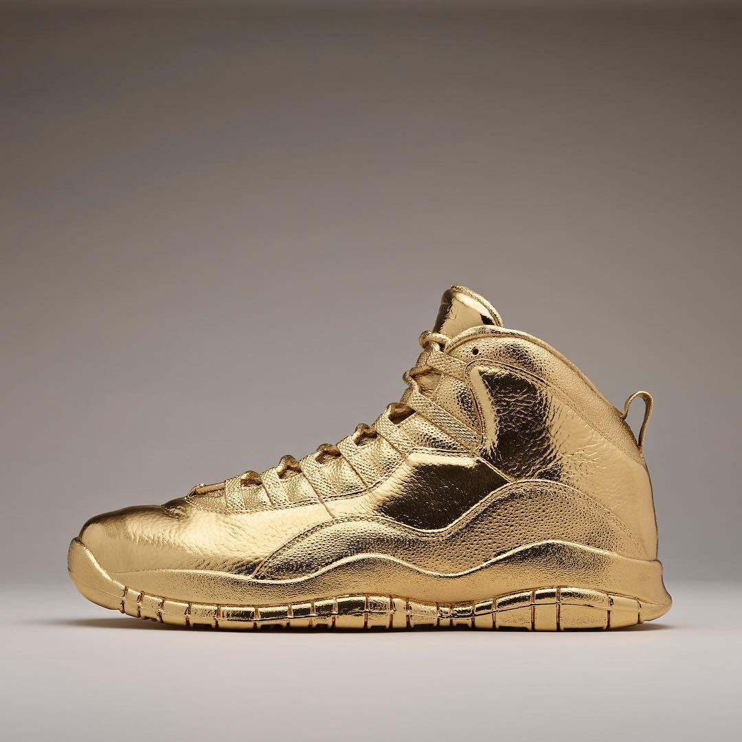 cheap for discount aa140 7bedf Drake's solid 24K gold Nike Air Jordans